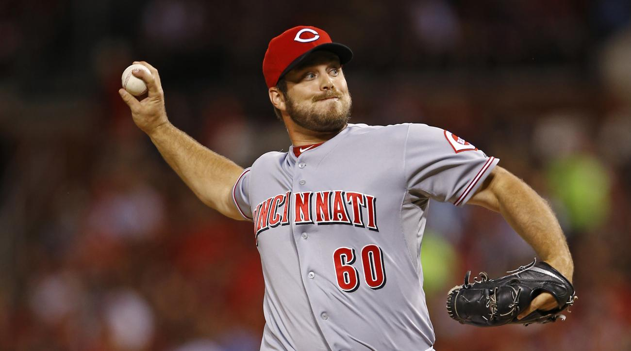 FILE - In this July 29, 2015 file photo, Cincinnati Reds relief pitcher J.J. Hoover throws during the eighth inning of a baseball game against the St. Louis Cardinals, in St. Louis. Hoover has won his salary arbitration case against the Cincinnati Reds, i