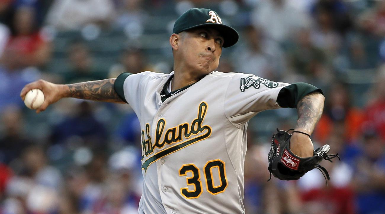 FILE - In this Sept. 11, 2015, file photo, Oakland Athletics starting pitcher Jesse Chavez works against the Texas Rangers during the first inning of a baseball game in Arlington, Texas. Chavez was awarded a $4 million salary on Saturday, Feb. 6, 2016, by