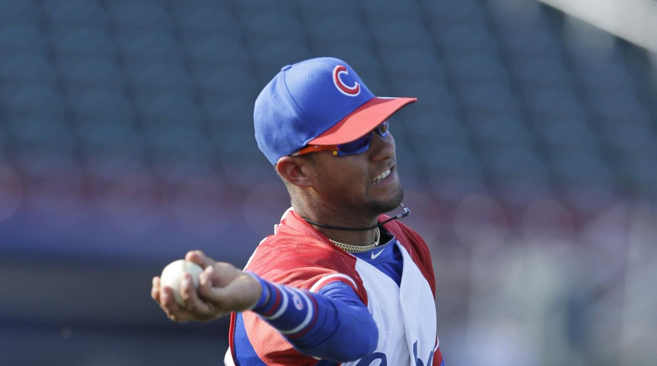 FILE - In this July 19, 2013 file photo, Cuba third baseman Yulieski Gourriel warms up prior to an exhibition baseball game against the United States in Papillion, Neb. A baseball official in the Dominican Republic said on Monday, Feb. 8, 2016, that Gourr