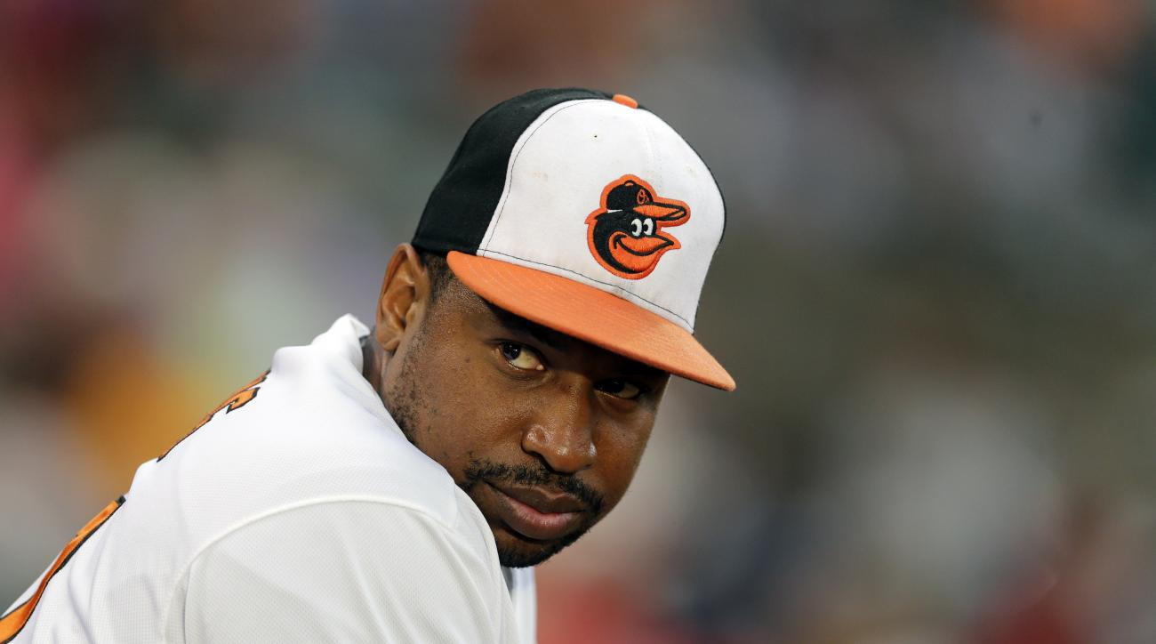 Baltimore Orioles' Delmon Young looks out from the dugout during an interleague baseball game against the Philadelphia Phillies, Monday, June 15, 2015, in Baltimore. (AP Photo/Patrick Semansky)