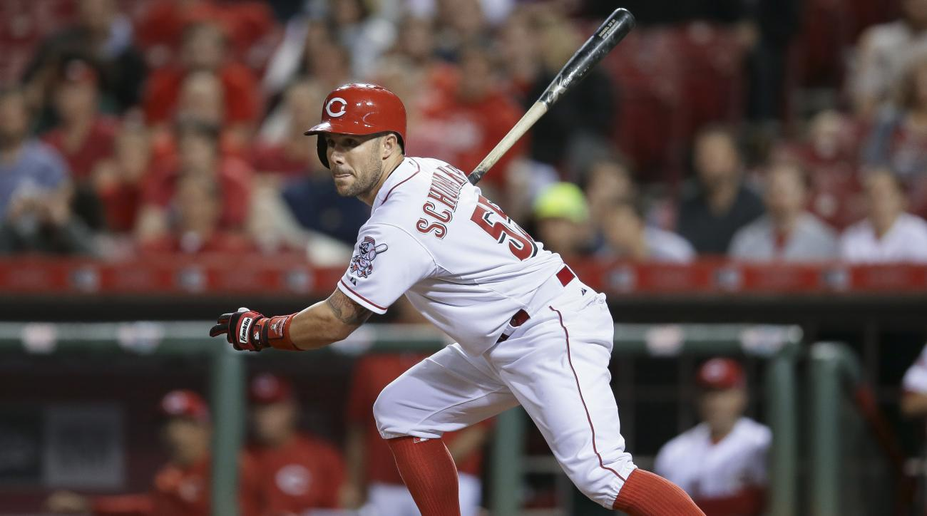 FILE - In this May 26, 2015, file photo, Cincinnati Reds' Skip Schumaker watches his his game-winning double in the ninth inning of a baseball game against the Colorado Rockies in Cincinnati. Schumaker has agreed to a minor league contract Tuesday, Feb. 9