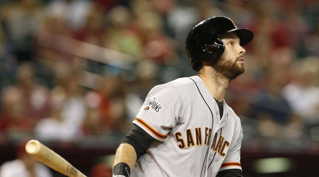 San Francisco Giants first baseman Brandon Belt (9) hits in the eighth inning during a baseball game against the Arizona Diamondbacks, Monday, Sept. 7, 2015, in Phoenix. (AP Photo/Rick Scuteri)
