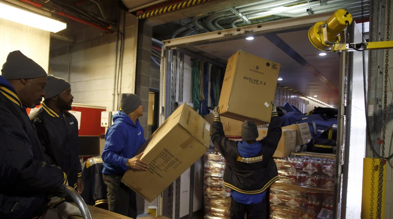 Workers load equipment bound for the St. Louis Cardinals spring training baseball facility in Jupiter, Fla., Thursday, Feb. 11, 2016, in St. Louis. Cardinals pitchers and catchers are scheduled to report to camp on Feb. 17, 2016. (AP Photo/Jeff Roberson)
