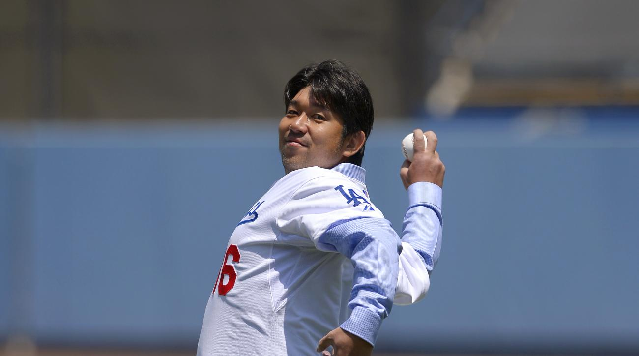 Former Los Angeles Dodgers pitcher Hideo Nomo, of Japan, throws out the ceremonial first pitch prior to the Dodgers' baseball game against the Tampa Bay Rays, Saturday, Aug. 10, 2013, in Los Angeles. (AP Photo/Mark J. Terrill)