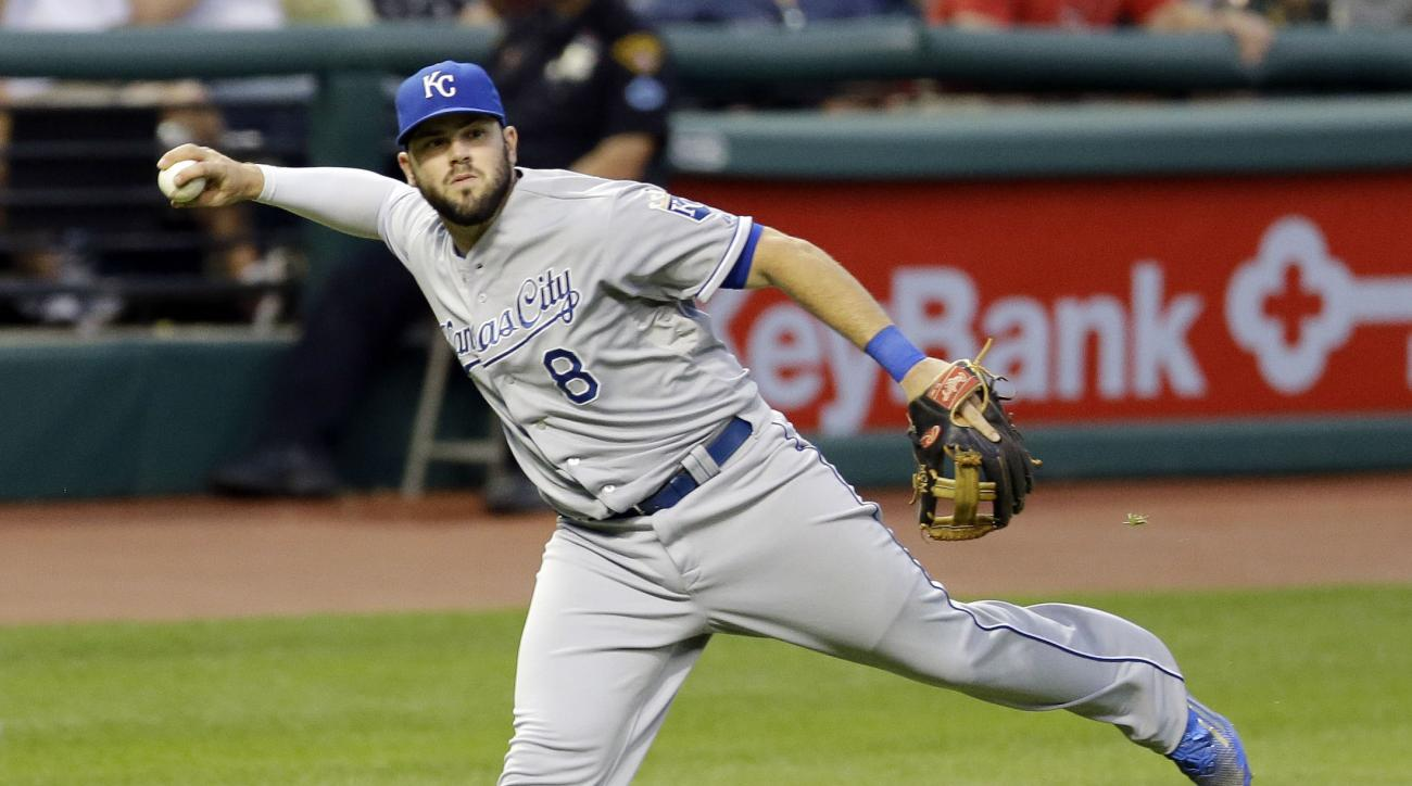 FILE - In this Tuesday, July 28, 2015 file photo, Kansas City Royals' Mike Moustakas looks but can't make the throw to first base to get Cleveland Indians' Carlos Santana out in the fifth inning of a baseball game in Cleveland. The Royals and third basema