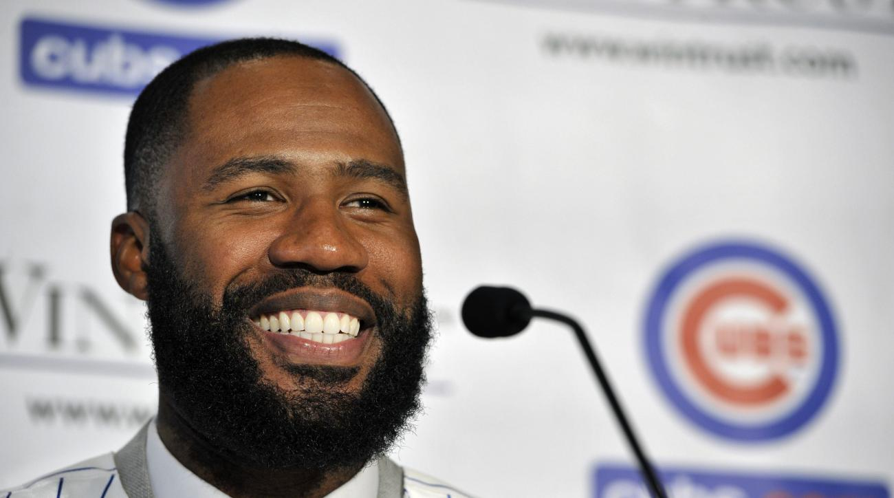 FILE - In this Dec. 15, 2015, file photo, Chicago Cubs newly acquired outfielder Jason Heyward speaks to the media during a news conference, in Chicago. Spring training is a time for optimism, when players bask under the warm sun of Florida and Arizona wh