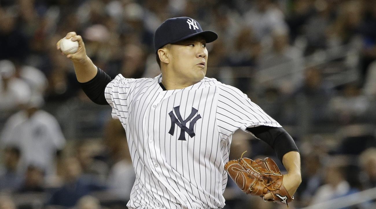 New York Yankees pitcher Masahiro Tanaka delivers against the Houston Astros during the first inning of the American League wild card baseball game Tuesday, Oct. 6, 2015, in New York. (AP Photo/Julie Jacobson)