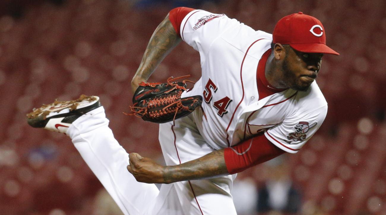 FILE - This Sept. 30, 2015 file photo shows Cincinnati Reds relief pitcher Aroldis Chapman throwing in the ninth inning of a baseball game against the Chicago Cubs in Cincinnati. Yankees manager Joe Girardi said, Monday, Jan. 11, 2016, newly acquired left