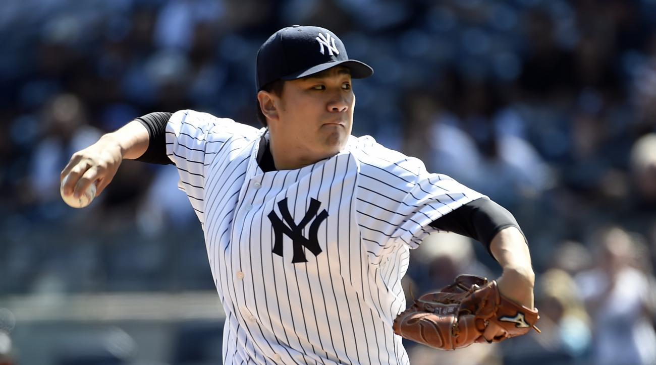 FILE - In this Sept. 13, 2015, file photo, New York Yankees starter Masahiro Tanaka pitches in the first inning of a baseball game against the Toronto Blue Jays in New York. Tanaka, coming back after arthroscopic surgery to remove a bone spur from his rig