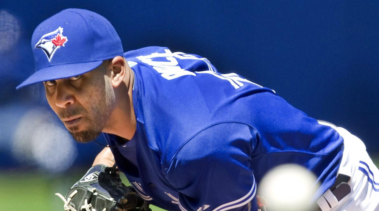 FILE - In this Aug, 3, 2015, file photo, Toronto Blue Jays' new starting pitcher David Price works against the Minnesota Twins during the first inning of a baseball game in Toronto. Price is among the top players to join the AL East. (Fred Thornhill/The C