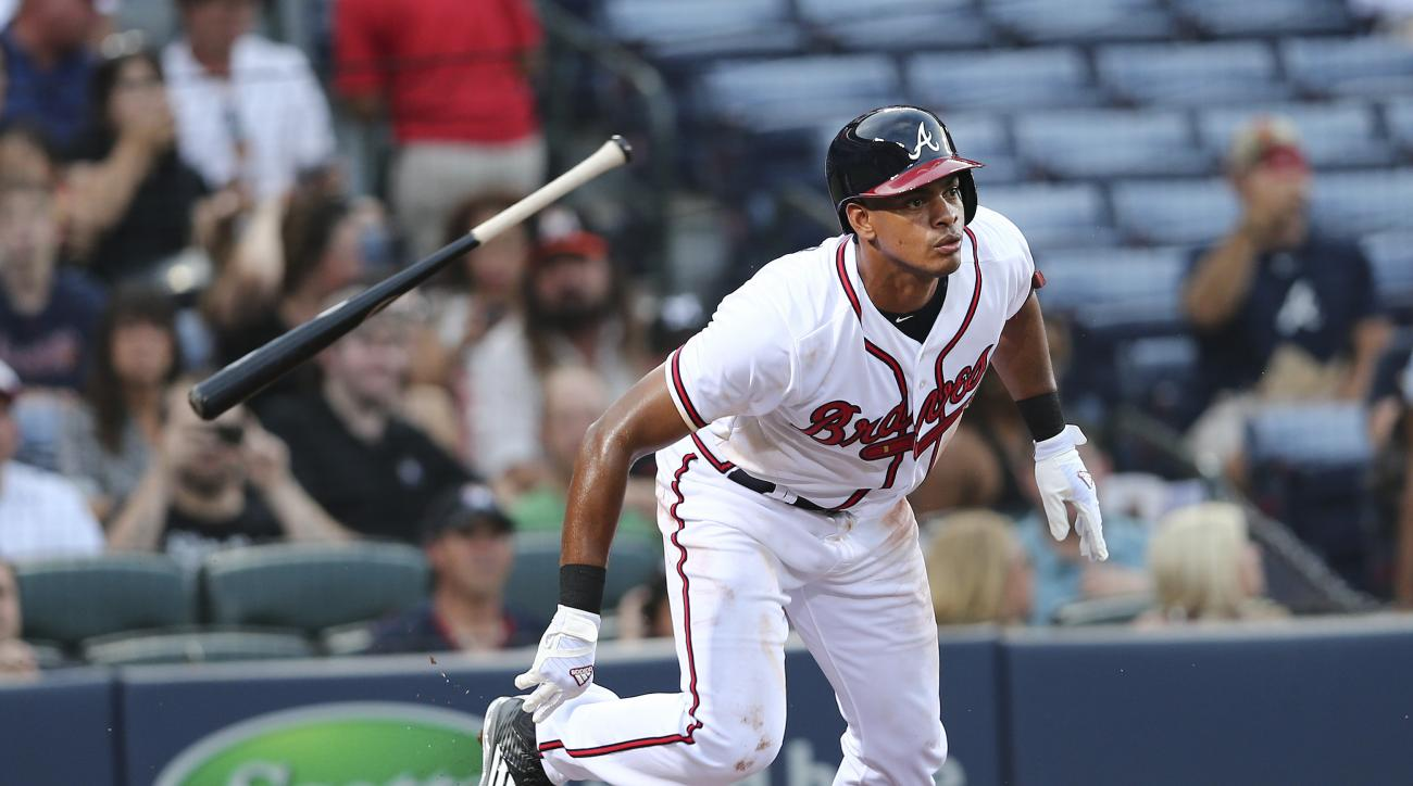 FILE - In this Tuesday, Sept. 1, 2015, file photo, Atlanta Braves' Hector Olivera, of Cuba, runs to first as he grounds out in his first Major League at bat in the second inning of a baseball game against the Miami Marlins in Atlanta. The Braves have pinn