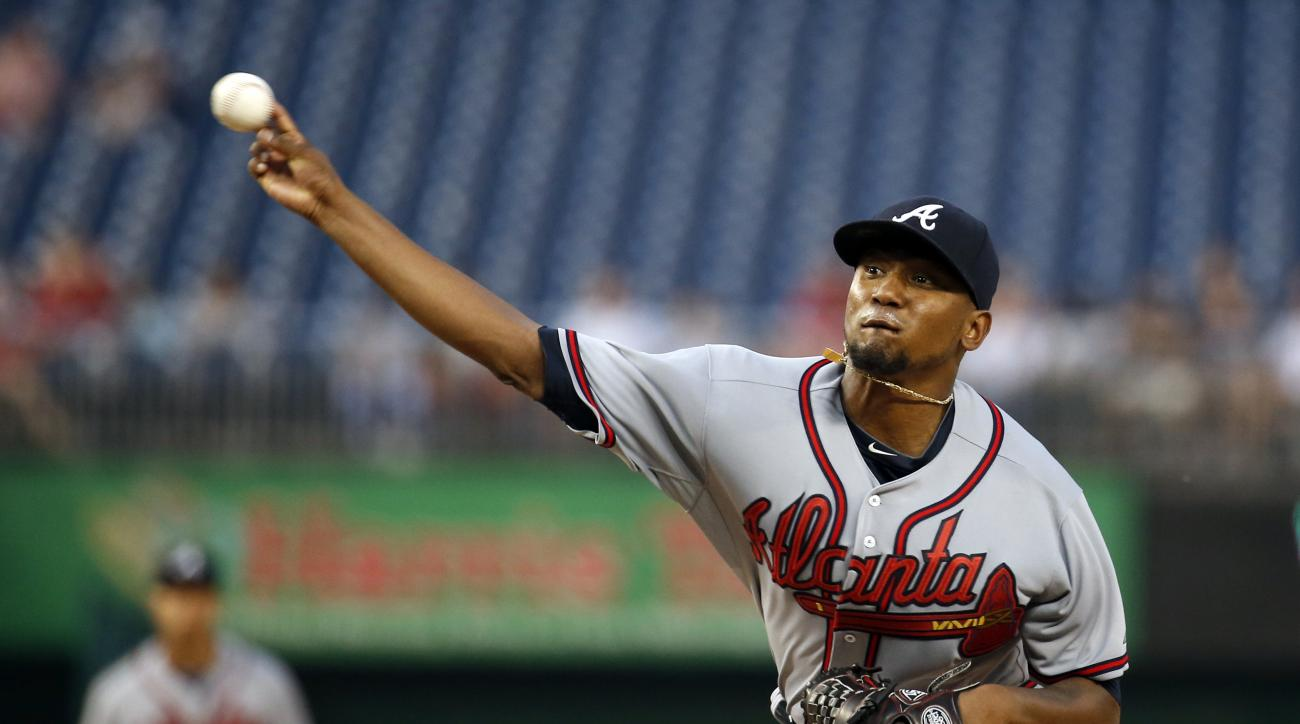 FILE - In this Friday, Sept. 4, 2015, file photo, Atlanta Braves starting pitcher Julio Teheran throws during the first inning of a baseball game against the Washington Nationals at Nationals Park, in Washington. The Braves are in the midst of a massive r