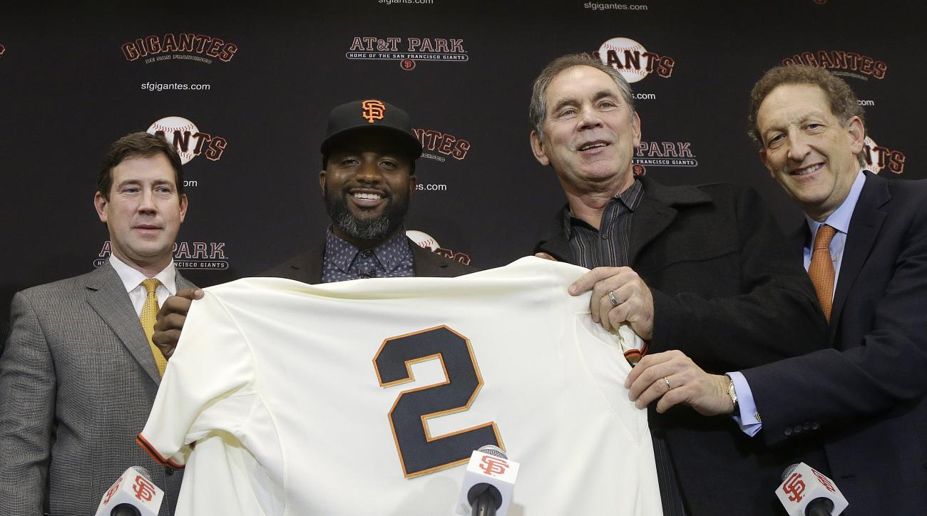 FILE - In this Jan. 8, 2016, file photo, San Francisco Giants outfielder Denard Span, center left, holds up a jersey between general manager Bobby Evans, left, manager Bruce Bochy, second from right, and president and CEO Larry Baer at a news conference i