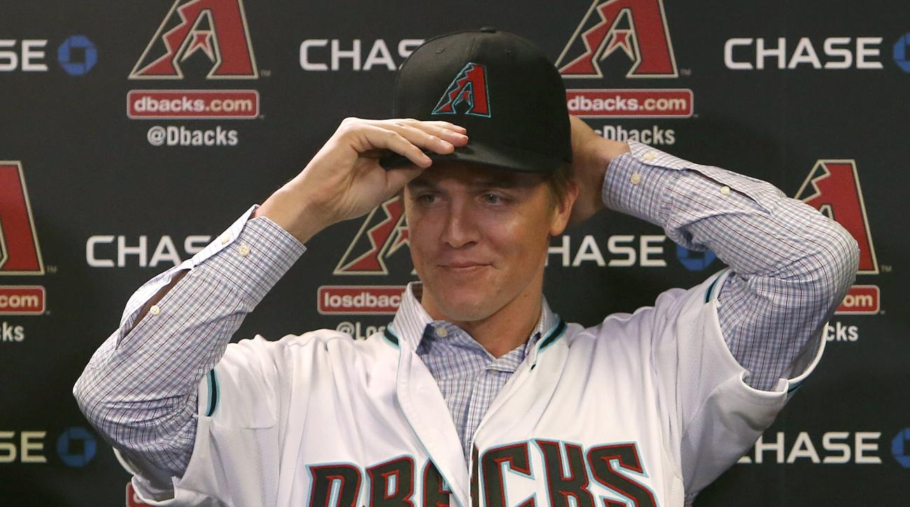 FILE - In this Dec. 11, 2015, file photo, Arizona Diamondbacks pitcher Zack Greinke talks to the media during a press conference in Phoenix. The addition of Zack Greinke, and a couple of other offseason moves, have the Diamondbacks expecting to be contend
