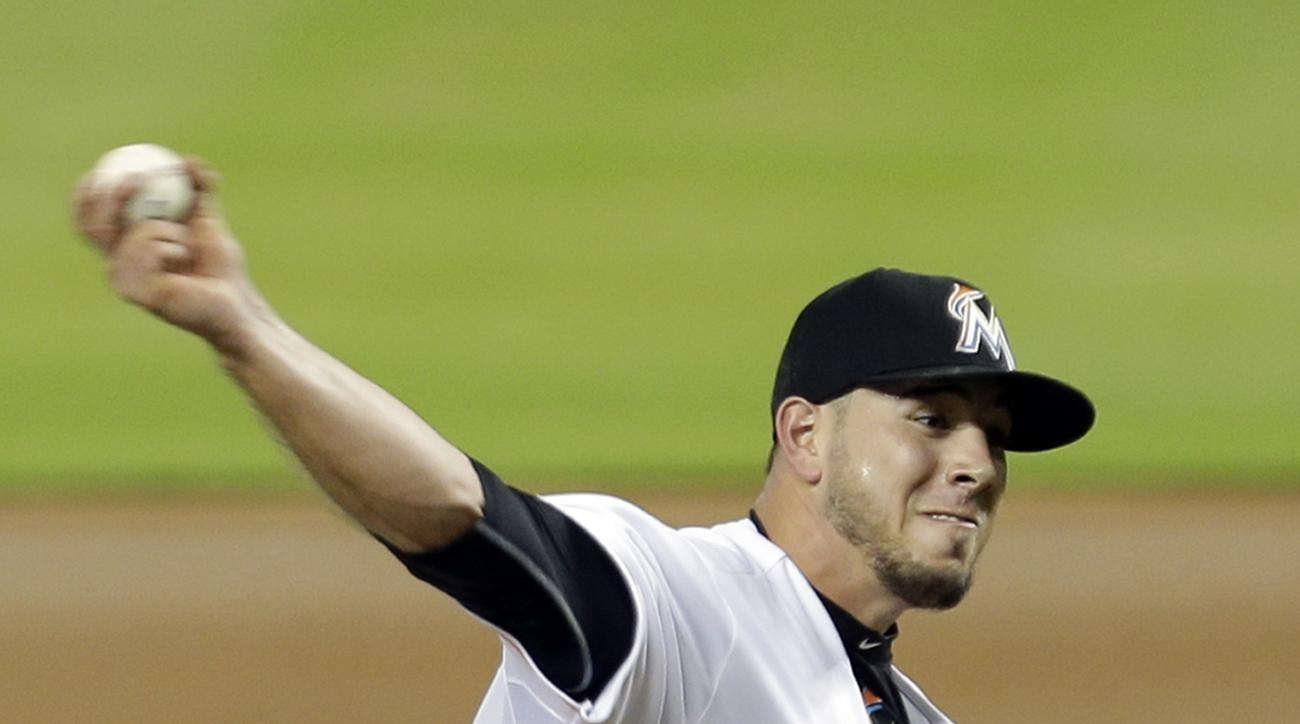 FILE - In this July 28, 2015, file photo, Miami Marlins' Jose Fernandez pitches against the Washington Nationals in the first inning of a baseball game in Miami. The last time Miami Marlins slugger Giancarlo Stanton and ace Jose Fernandez were in the line