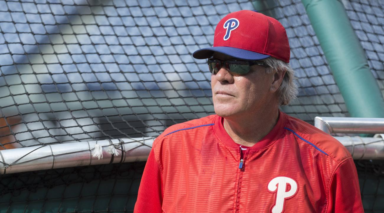 FILE - In this July 20, 2015, file photo, Philadelphia Phillies interim manager Pete Mackanin looks on during warm-ups prior to the first inning of a baseball game against the Tampa Bay Rays, in Philadelphia. Manager Pete Mackanin starts his first full se