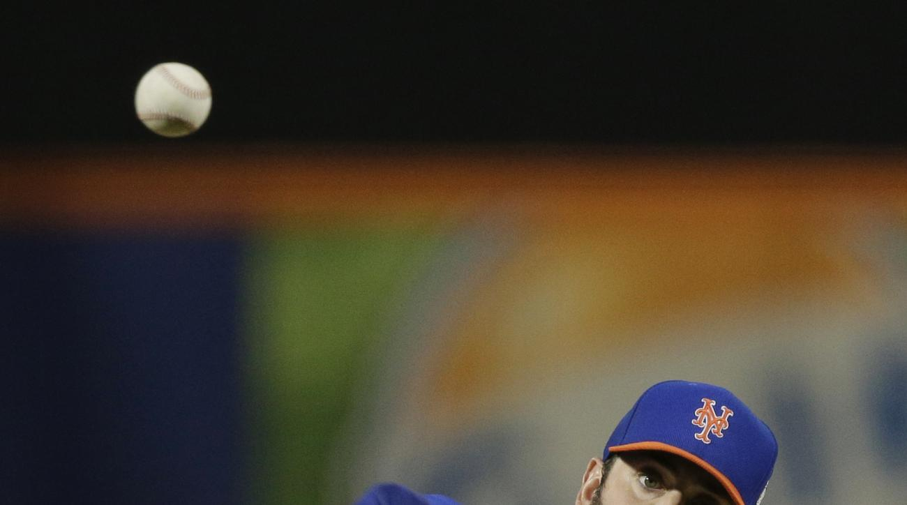 New York Mets pitcher Matt Harvey throws during the first inning of Game 5 of the Major League Baseball World Series against the Kansas City Royals Sunday, Nov. 1, 2015, in New York. (AP Photo/Julie Jacobson, Pool)