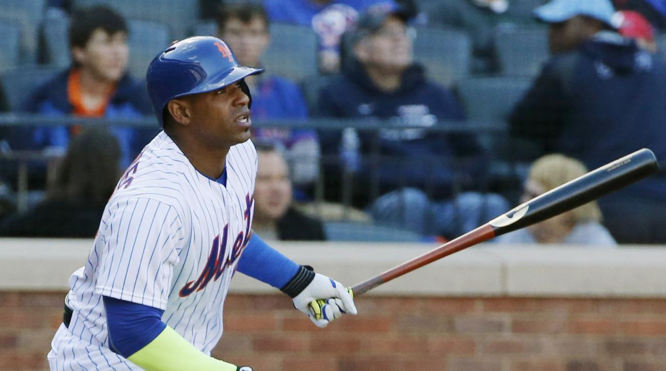 FILE - In this Sunday, Oct. 4, 2015 file photo, New York Mets Yoenis Cespedes watches his fourth-inning double in a baseball game against the Washington Nationals in New York. After nothing but misery for nearly a decade, the Mets have grown into a Nation