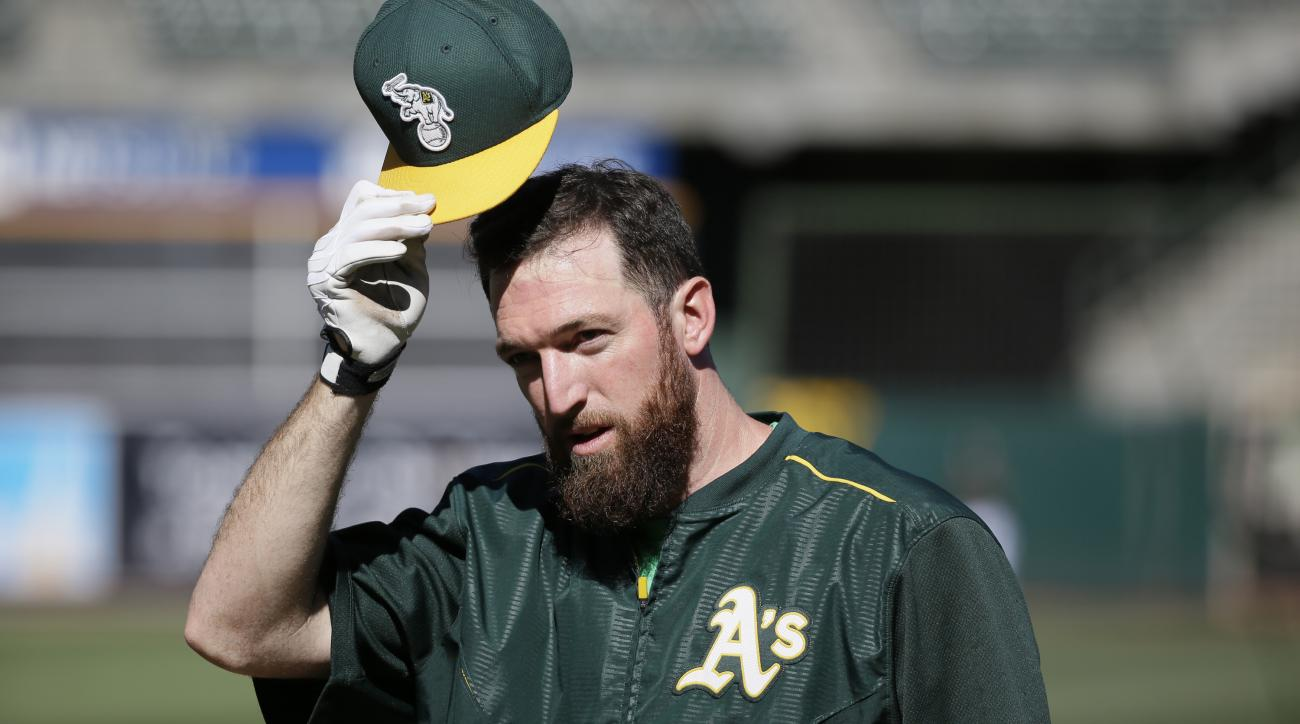 File - In this Monday, June 29, 2015 file photo, Oakland Athletics first baseman Ike Davis greets before the start of their baseball game against the Colorado Rockies in Oakland, Calif. Free-agent first baseman Davis has agreed to a minor league contract
