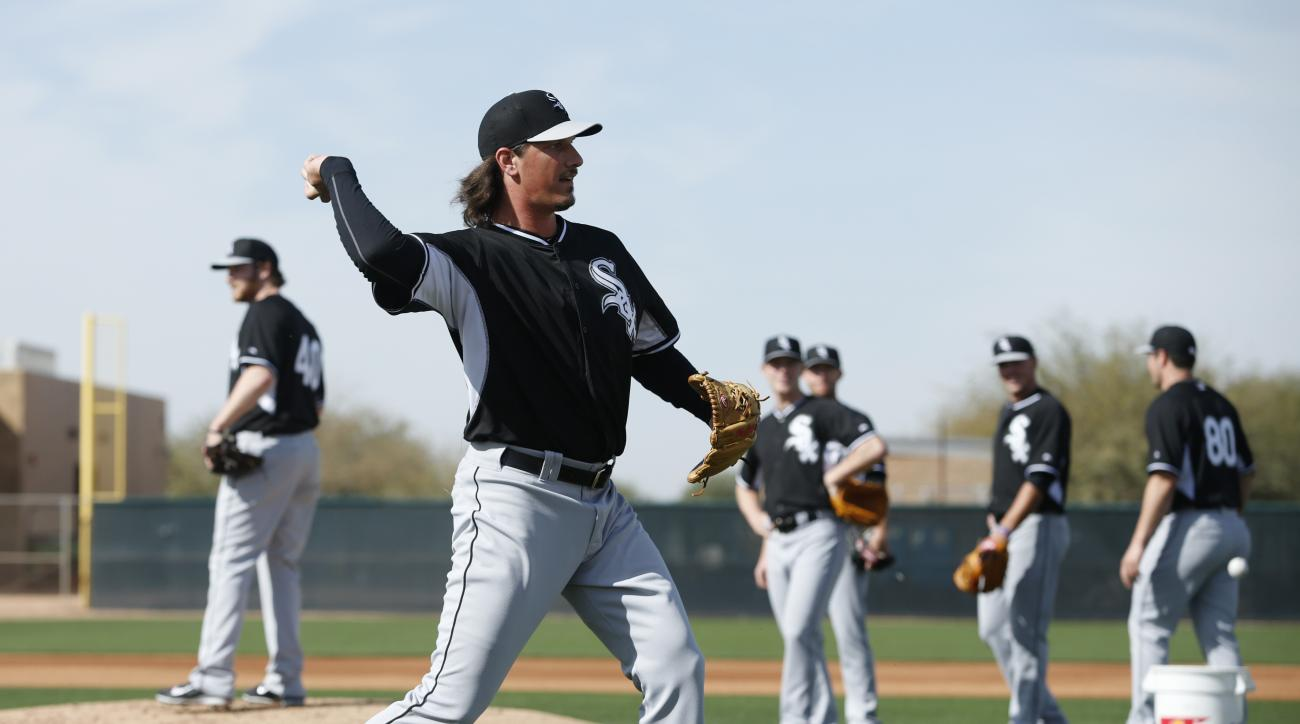 FILE - In this Saturday, Feb. 21, 2015, file photo, Chicago White Sox's Jeff Samardzija throws during a spring training baseball workout in Phoenix. This time last year, the White Sox welcomed the start of spring training with visions of a playoff run aft