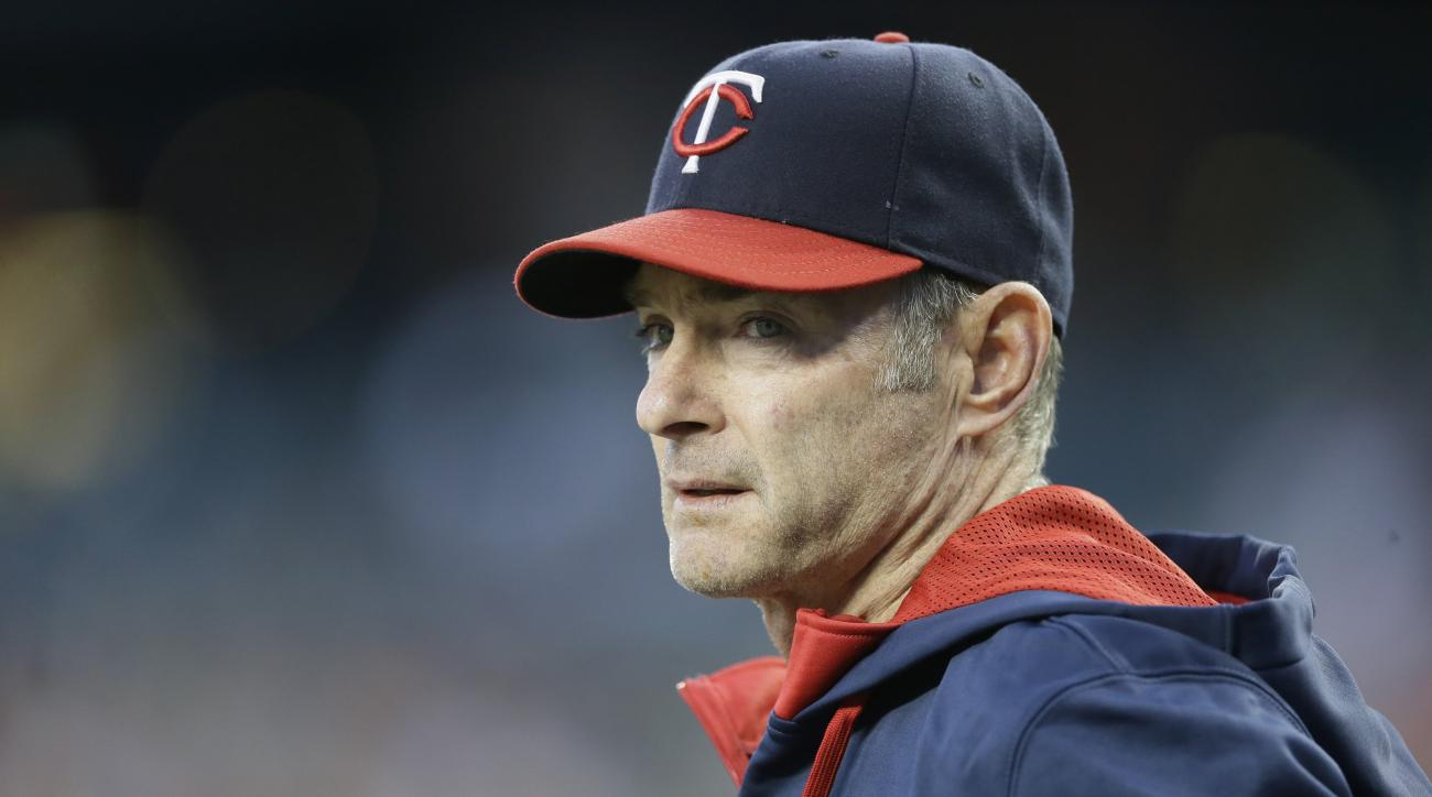FILE - In this Sept. 26, 2015, file photo, Minnesota Twins manager Paul Molitor looks out from the dugout during the first inning of a baseball game against the Detroit Tigers, in Detroit. (AP Photo/Carlos Osorio)