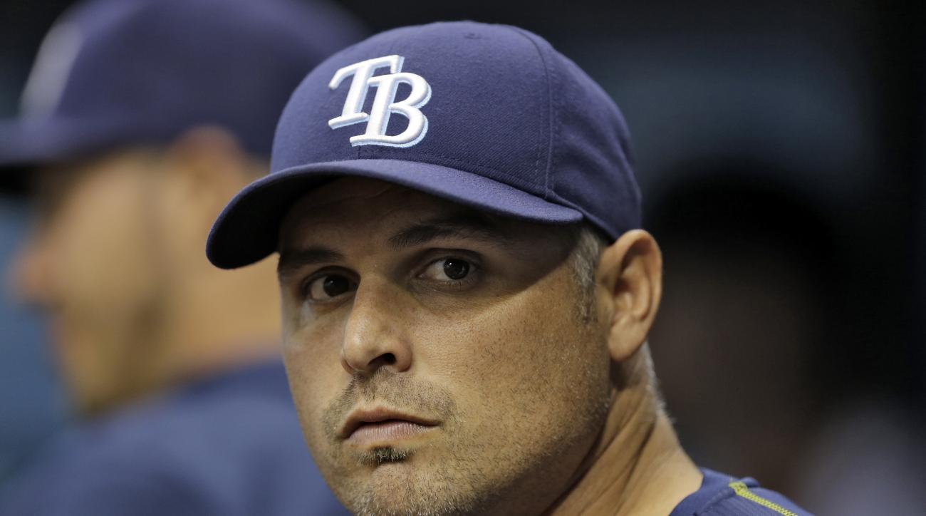 FILE - In this Sept. 29, 2015, file photo, Tampa Bay Rays manager Kevin Cash looks on during the first inning of an interleague baseball game against the Miami Marlins,  in St. Petersburg, Fla. Second-year manager Kevin Cash will spend training trying to