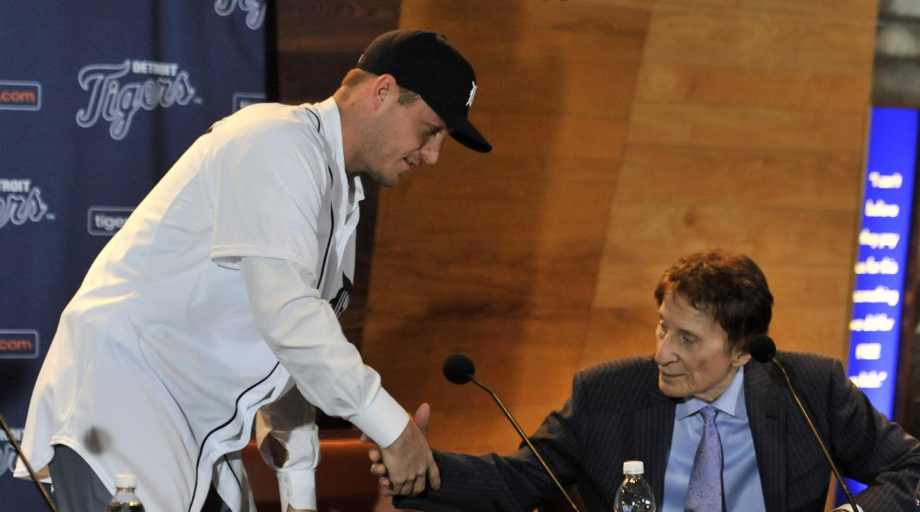FILE - In this Nov. 30, 2015, file photo, Detroit Tigers pitcher Jordan Zimmermann shakes hands with Tigers owner Mike Ilitch, right, during the news conference in Detroit. An offseason of big spending may put the Detroit Tigers back in contention after a
