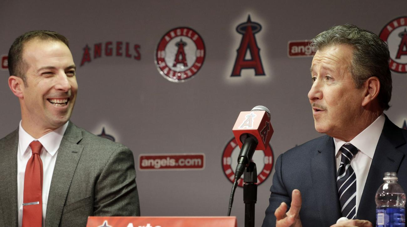 FILE - In this Oct. 5, 2015, file photo, Los Angeles Angels owner Arte Moreno, right, talks during a news conference announcing longtime Yankees executive Billy Eppler, left, as the new Angels general manager in Anaheim, Calif. Although the Los Angeles An