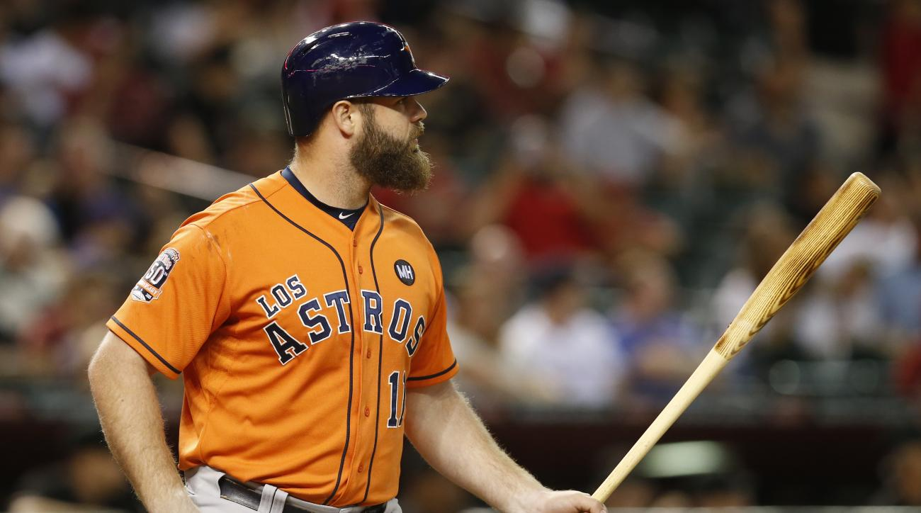 Houston Astros designated hitter Evan Gattis (11) hits against the Arizona Diamondbacks in the first inning during a baseball game, Saturday, Oct. 3, 2015, in Phoenix. (AP Photo/Rick Scuteri)
