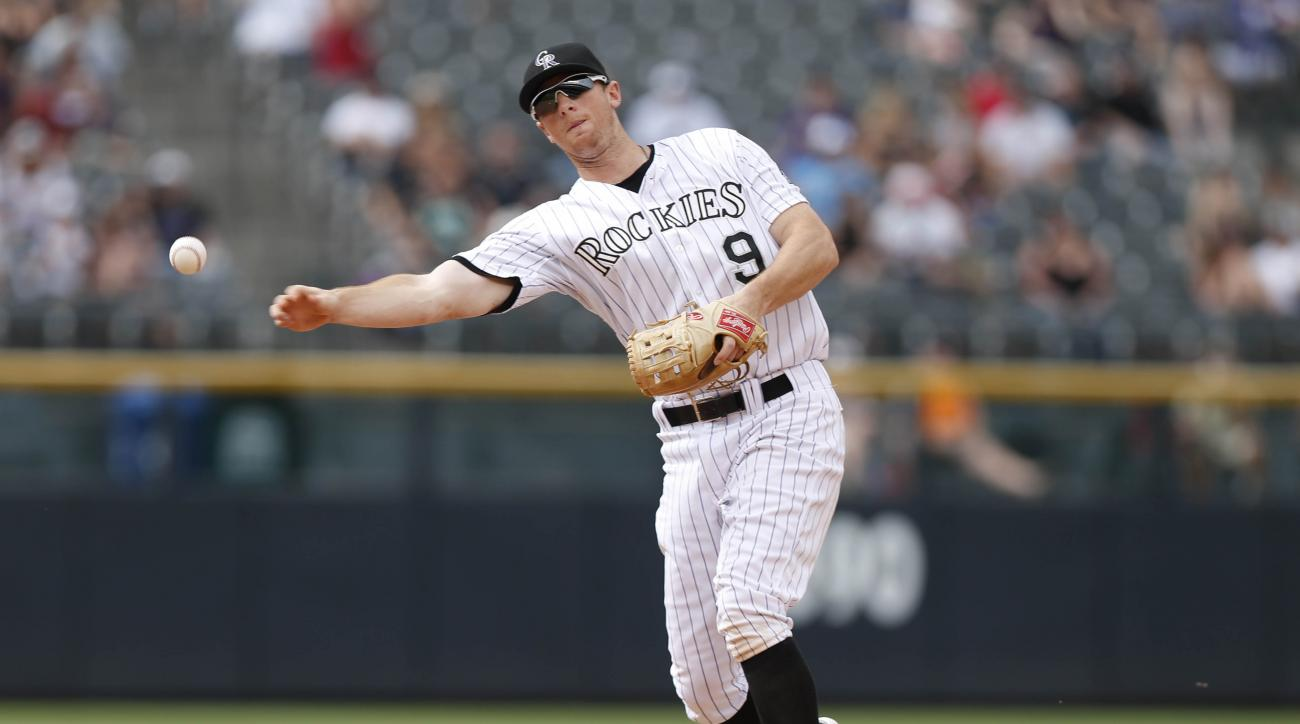FILE - In this Sunday, Aug. 16, 2015 file photo, Colorado Rockies second baseman DJ LeMahieu (9) throws to first base for put out against the San Diego Padres in the eighth inning of a baseball game in Denver. All-Star second baseman DJ LeMahieu and the C