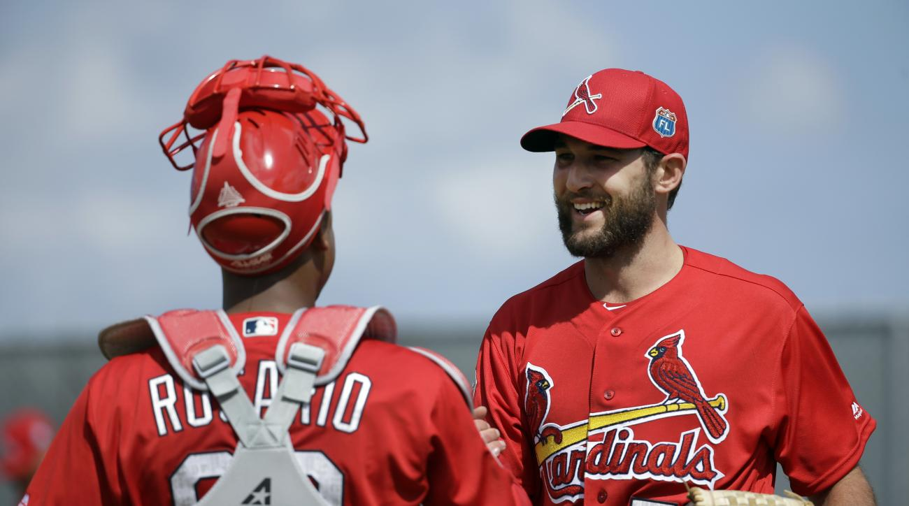 St. Louis Cardinals pitcher Michael Wacha, right, shakes hands after throwing a bullpen session to Alberto Rosario during spring training baseball practice Thursday, Feb. 18, 2016, in Jupiter, Fla. (AP Photo/Jeff Roberson)