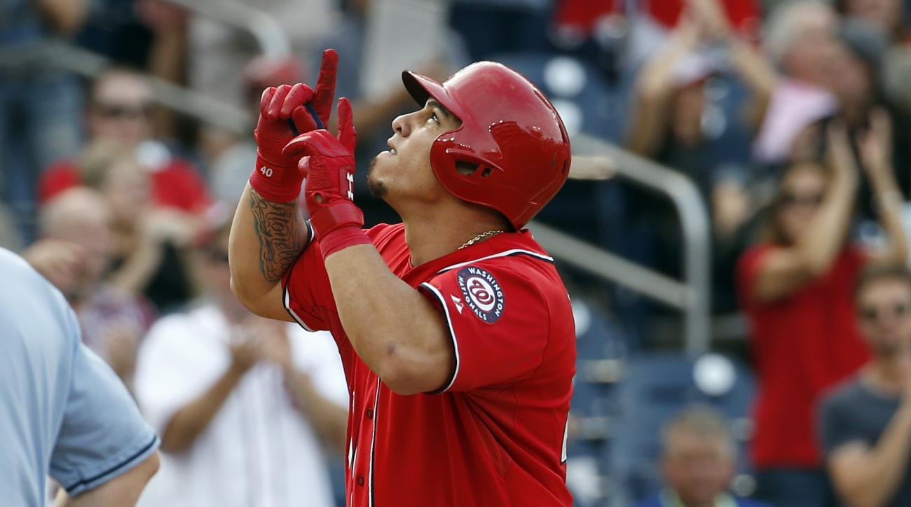 FILE - In this Sept. 28, 2015, file photo, Washington Nationals catcher Wilson Ramos celebrates after his solo home run during the fifth inning of a baseball game against the Cincinnati Reds, at Nationals Park in Washington. Pitchers and catchers, many wh