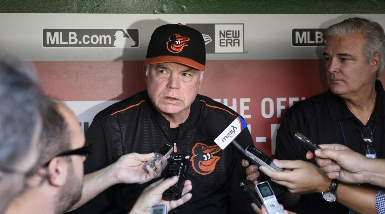 FILE - In this Sept. 23, 2015, file photo, Baltimore Orioles manager Buck Showalter talks to reporters before an interleague baseball game against the Washington Nationals, in Washington. After a productive offseason where they retained three of their mai