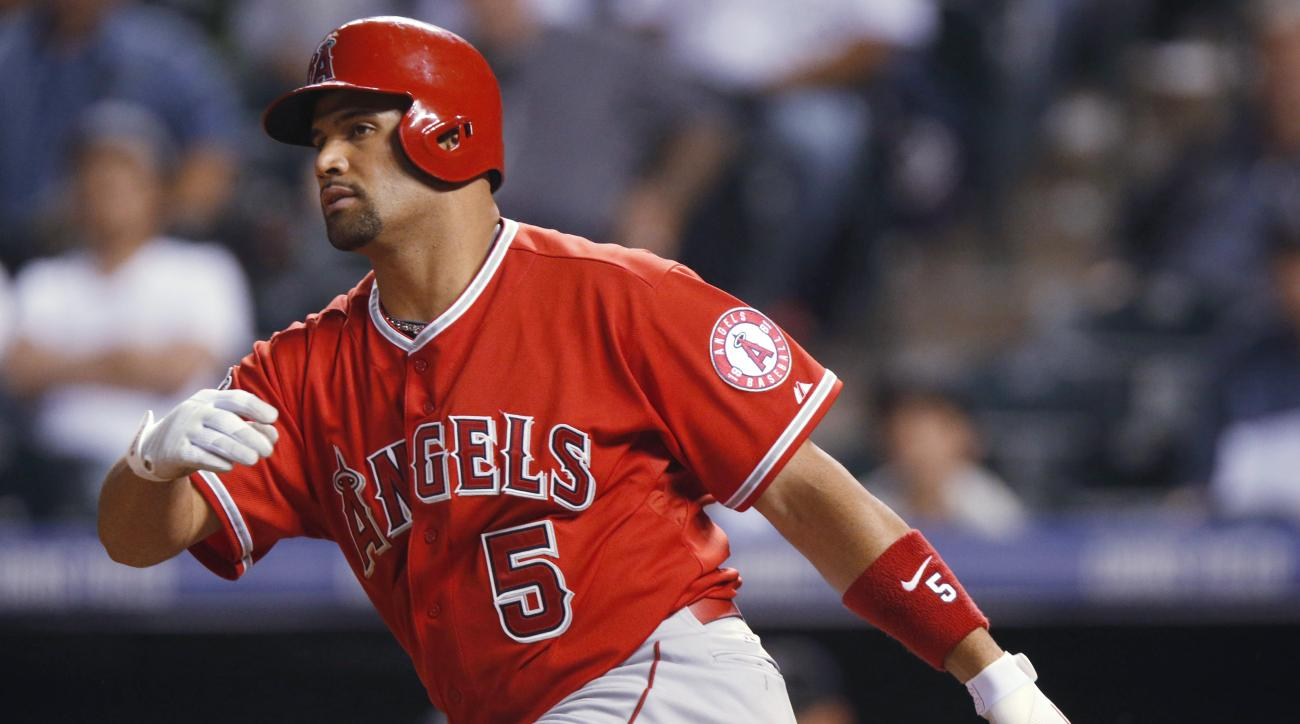 FILE - In this Tuesday, July 7, 2015 file photo, Los Angeles Angels' Albert Pujols grounds out against the Colorado Rockies in the ninth inning of a baseball game in Denver. The Los Angeles Angels are preparing to start the season without slugger Albert P