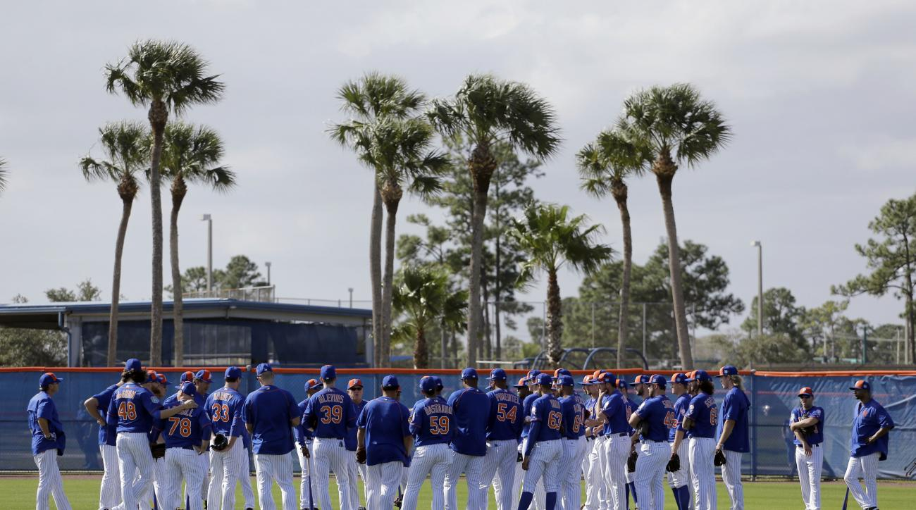 Members of the New York Mets gather at the start of spring training baseball practice Friday, Feb. 19, 2016, in Port St. Lucie, Fla. (AP Photo/Jeff Roberson)