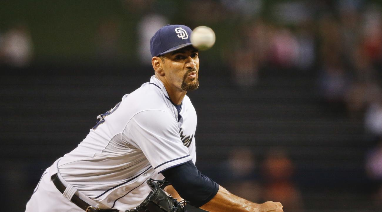 FILe - In this Aug. 31, 2015, file photo, San Diego Padres starting pitcher Tyson Ross works against the Texas Rangers in the first inning of a baseball game, in San Diego. New manager Andy Green has picked Tyson Ross as the opening day starter against th