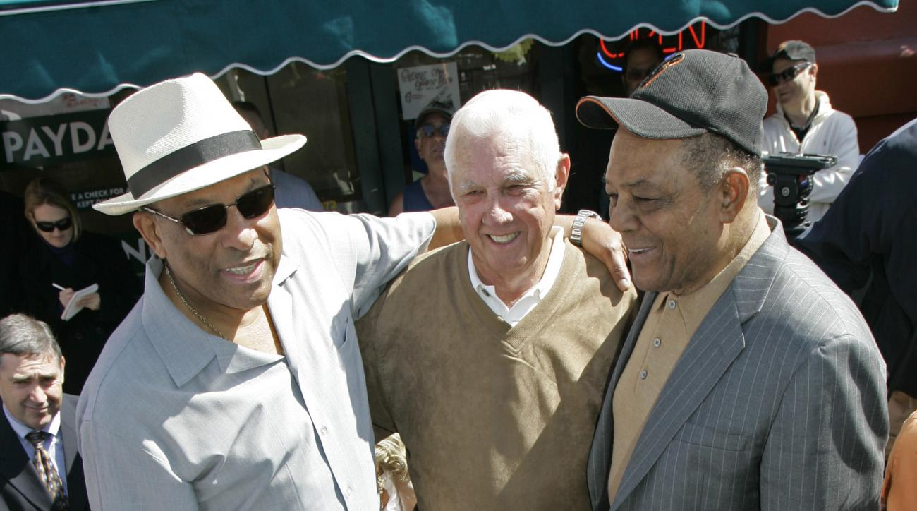 FILE - In this April 15, 2008, file photo, from left, San Francisco Giants Hall of Famer Orlando Cepeda, former third baseman and manager Jim Davenport, and Hall of Famer Willie Mays stand over a plaque commemorating the San Francisco Giants 50th annivers