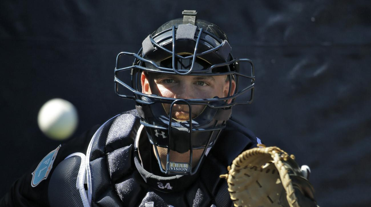 New York Yankees catcher Brian McCann prepares to catch the ball during a spring training baseball workout Friday, Feb. 19, 2016, in Tampa, Fla. (AP Photo/Chris O'Meara)