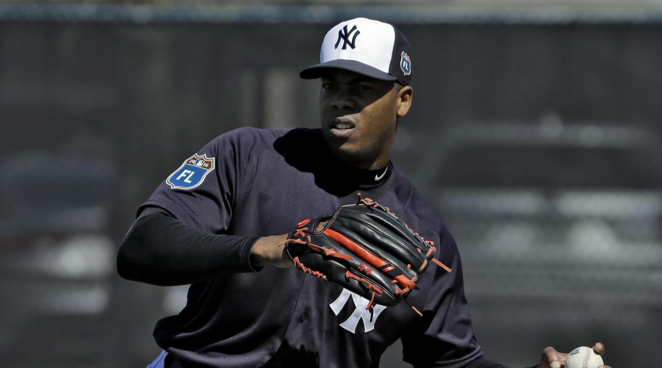 New York Yankees pitcher Aroldis Chapman throws a ball during a spring training baseball workout Friday, Feb. 19, 2016, in Tampa, Fla. (AP Photo/Chris O'Meara)