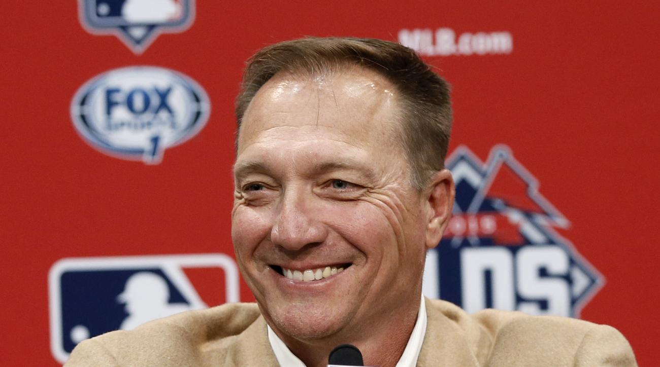 FILE - In this Oct. 13, 2015, file photo, Texas Rangers manager Jeff Banister smiles as he listens to a question during a news conference in Arlington, Texas. The Rangers have guaranteed Jeff Banister's contract through 2018 and given their manager a rais
