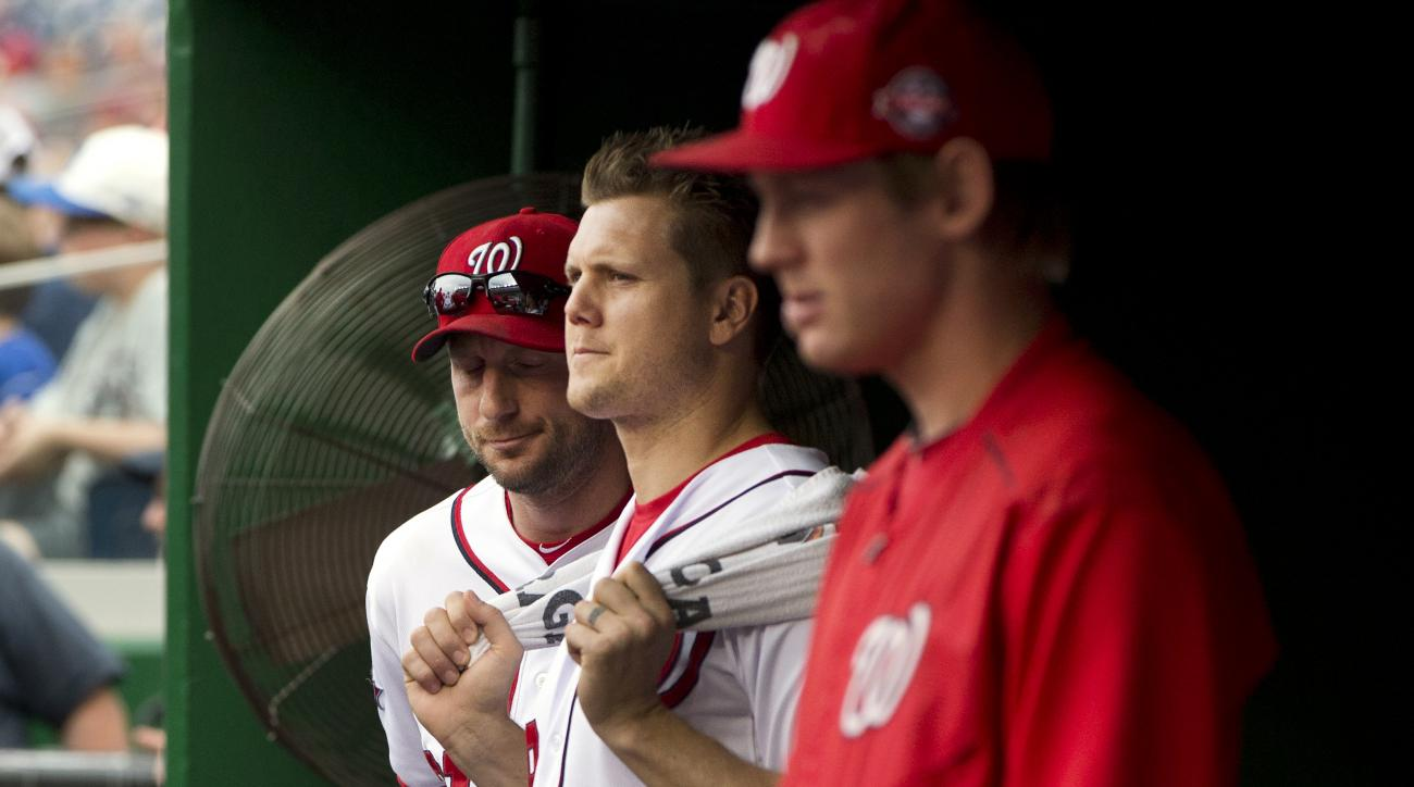 FILE - In this Sept. 27, 2015 file photo, Washington Nationals pitchers Jonathan Papelbon, center, flanked by Max Scherzer, left, and Stephen Strasburg watch the eighth inning of a baseball game against the Philadelphia Phillies at Nationals Park in Washi