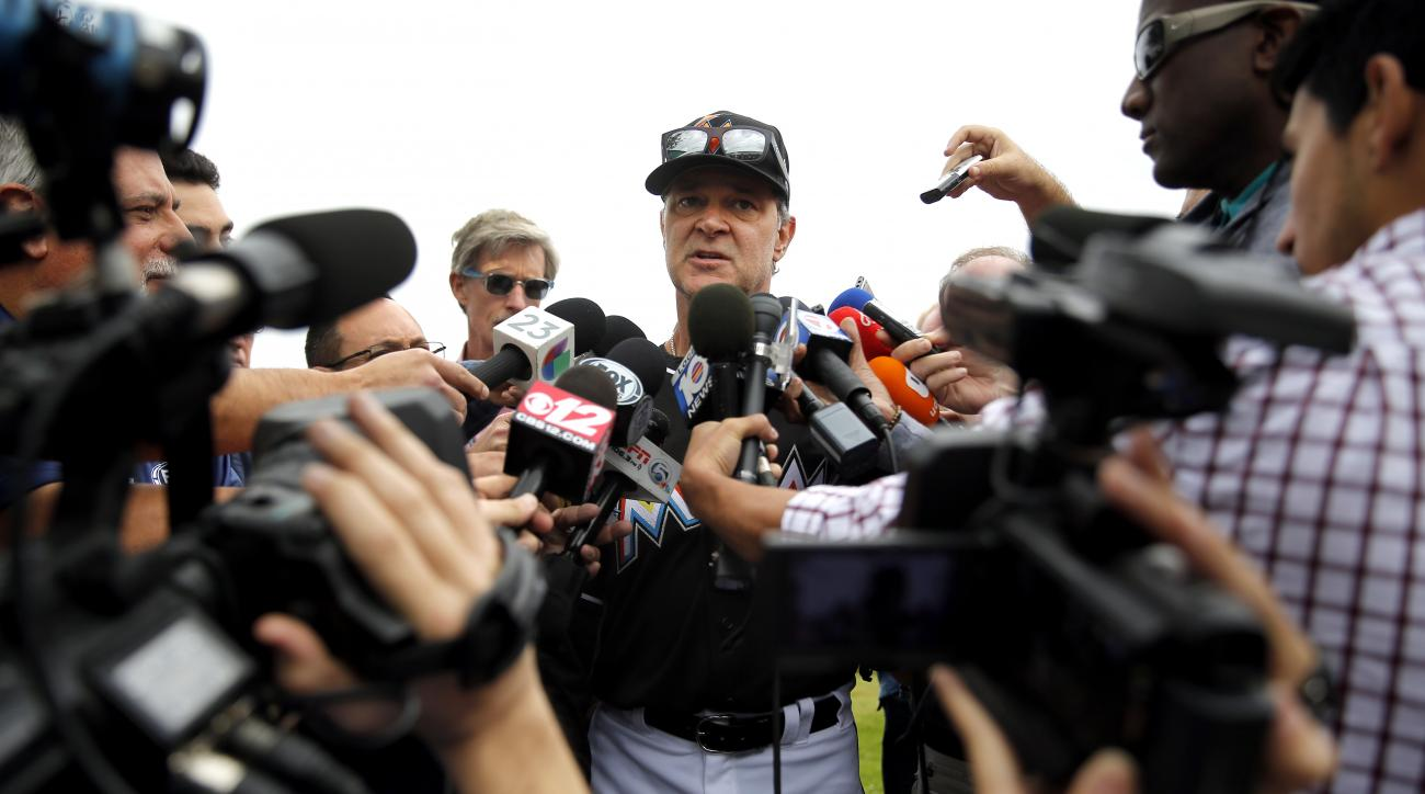 Miami Marlins manager Don Mattingly speaks to members of the media before the first official baseball practice for the team's pitchers and catchers of spring training Friday, Feb. 19, 2016, in Jupiter, Fla. (AP Photo/Jeff Roberson)