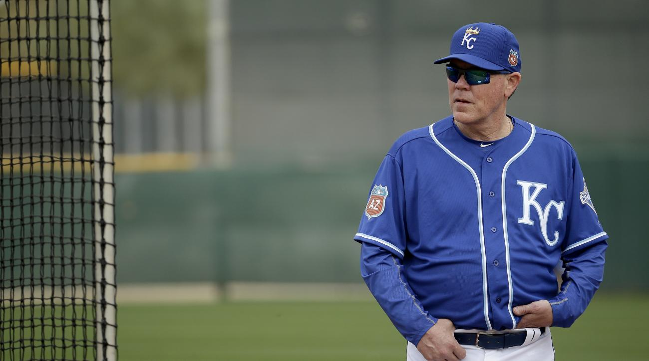 Kansas City Royals manager Ned Yost watches workouts during spring training baseball practice Friday, Feb. 19, 2016, in Surprise, Ariz. (AP Photo/Charlie Riedel)