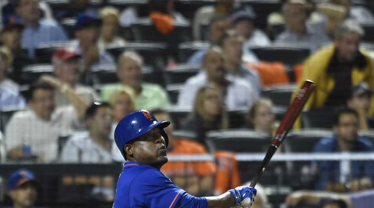 FILE - In this Sept. 18, 2015, file photo, New York Mets' Juan Uribe watches his two-run home run off of New York Yankees relief pitcher Chasen Shreve in the seventh inning of a baseball game, in New York. The Cleveland Indians have agreed to a one-year,