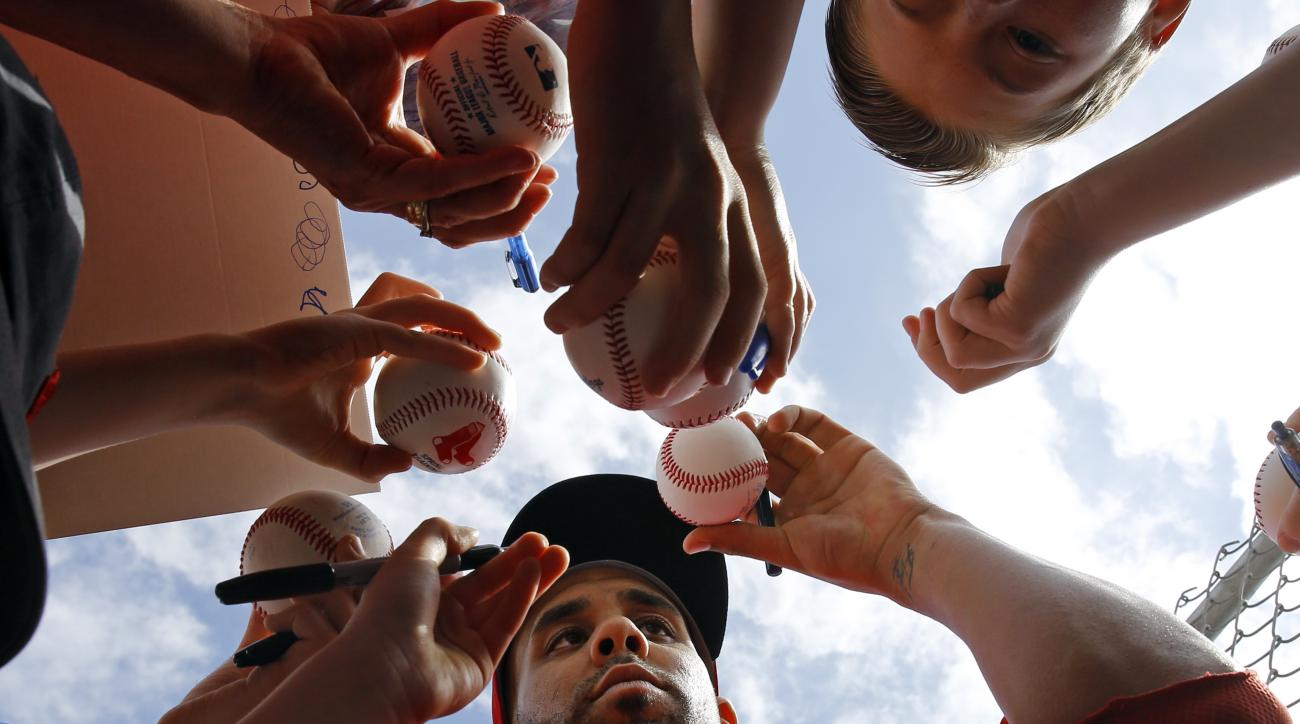 Boston Red Sox pitcher David Price signs autographs for fans after a spring training baseball workout in Fort Myers, Fla., Saturday, Feb. 20, 2016. (AP Photo/Patrick Semansky)