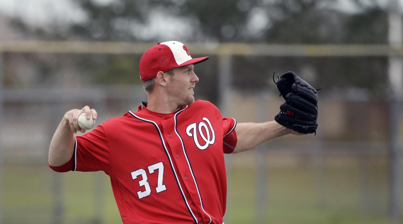 Washington Nationals pitcher Stephen Strasburg (37) warms up during a spring training baseball workout, Saturday, Feb. 20, 2016, in Viera, Fla. (AP Photo/John Raoux)