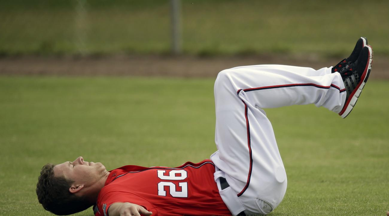 Washington Nationals pitcher Trevor Gott  stretches out after a spring training baseball workout, Saturday, Feb. 20, 2016, in Viera, Fla. (AP Photo/John Raoux)