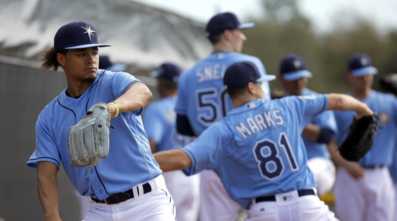 Tampa Bay Rays pitcher Chris Archer, left, throws a pitch during a spring training baseball workout in Port Charlotte, Fla., Sunday, Feb. 21, 2016. (AP Photo/Patrick Semansky)