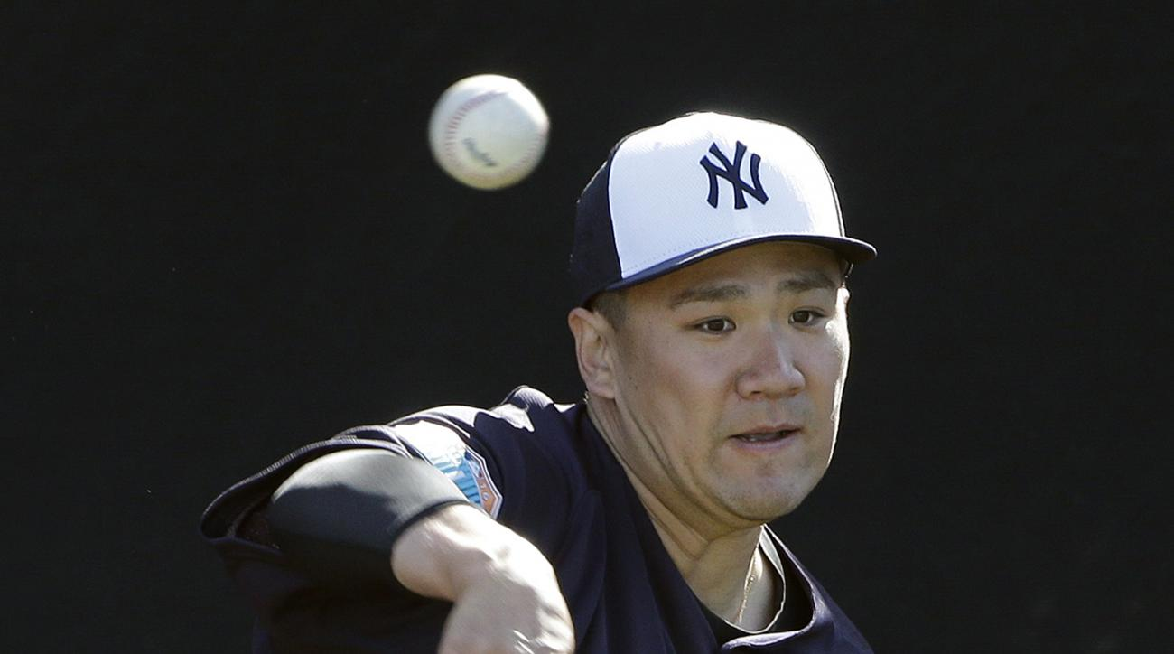 New York Yankees pitcher Masahiro Tanaka, of Japan, throws a bullpen session during a spring training baseball workout Monday, Feb. 22, 2016, in Tampa, Fla. (AP Photo/Chris O'Meara)