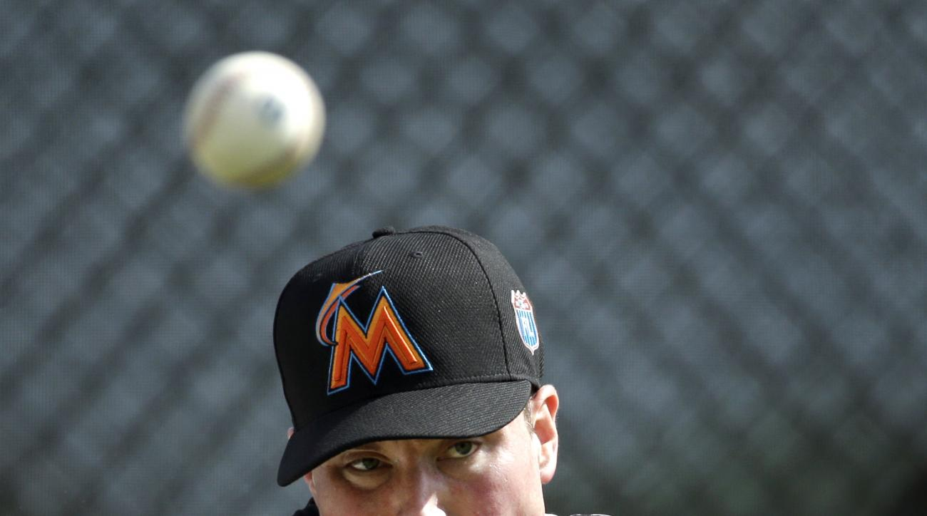 Miami Marlins pitcher Carter Capps throws a bullpen session during spring training baseball practice Monday, Feb. 22, 2016, in Jupiter, Fla. (AP Photo/Jeff Roberson)